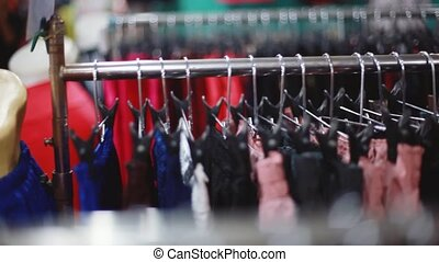 Clothing hanging on hangers at clothes shop. 1920x1080, hd