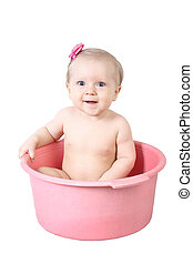 Cute baby having bath in pink tub