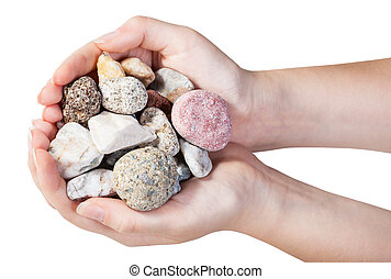 top view of various mineral pebbles in handful