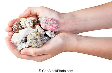 above view of various natural pebbles in handful