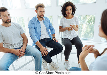 Nice depressed people having a group therapy session -...