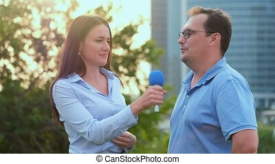 Young girl TV reporter is broadcasting - Young girl TV...