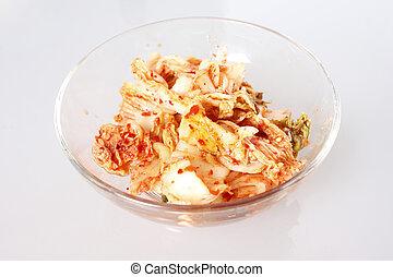 Kim chi in a glass bowl.