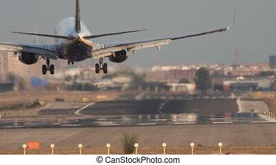 Jet landing, rear view - Rear view of jet landing to runway...