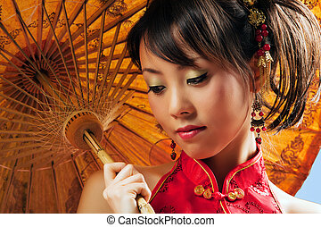 Asian girl - Chinese girl with parasol wearing a cheongsam