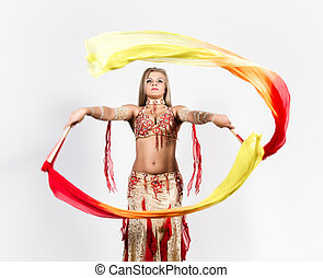 Arabic dance with fans and ribbons performed by a beautiful...
