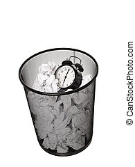 Wasting Time - Alarm Clock in a Wastebasket islated on white...