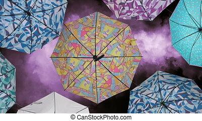 Colourful umbrellas against purple sky
