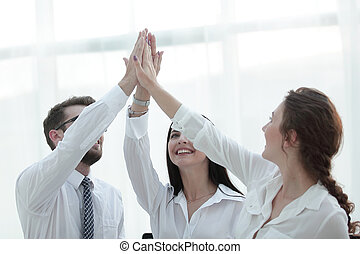 successful business team giving each other a high five....