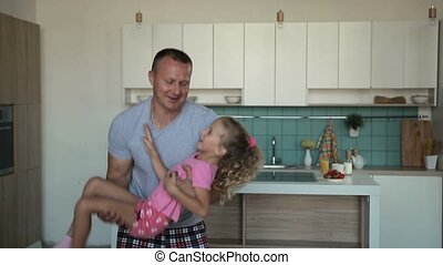 Devoted father spinning daughter in circle at home -...