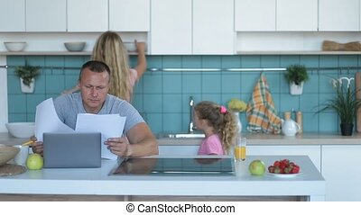 Confused man with laptop analyzing home finances - Family...
