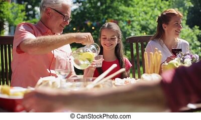 happy family having dinner or summer garden party - leisure,...
