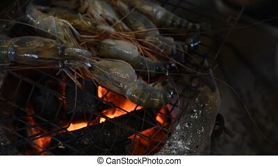 Grilled shrimp (Giant freshwater prawn) grilling with...
