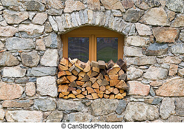 Firewood logpile stacked in a window - Austria