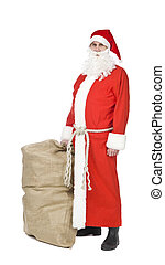 Santa Claus - Santa claus with a sack og gifts isolated on a...