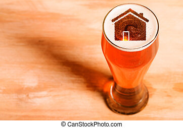 Local craft beer. House silhouette in glass of fresh beer on...