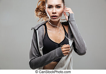 Cropped image of a young healthy fitness woman in sportswear...