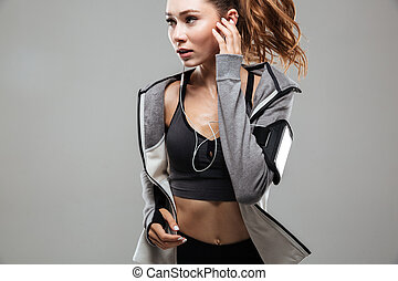 Cropped image of a pretty young fitness woman in sportswear...