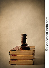 Pile of Old Books Topped with Gavel - Legal concept. A...