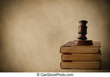 Wooden Gavel on Top of Old Books - Legal concept. A wooden...