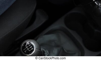 manual gear shift knob on a vehicle. hand of driver, driving...