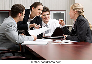 Partnership - Team of four business people working together