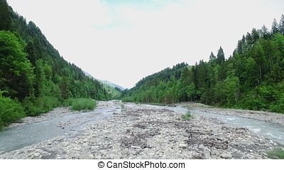 Mountain landscape. Footage. River goes around the mountain. Top view