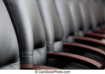 Row of chairs - Row of leather black chairs in a boardroom