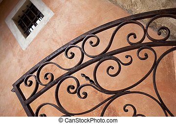 Wrought iron gate - Detail of a wrought iron gate of a house...