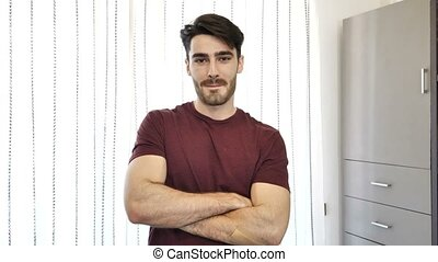 Confident young man at home with arms crossed - Confident...