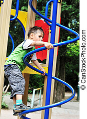 active boy - active little  boy climbing on the playground