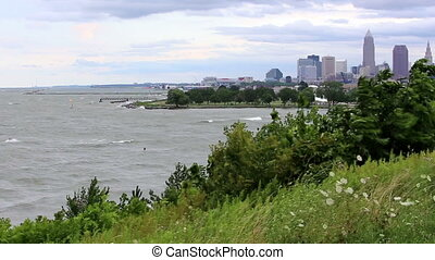 Lake Erie Kite surfers with city in background shot one -...