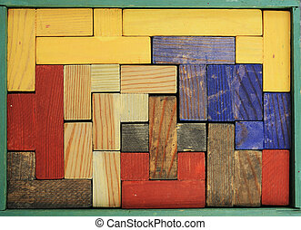 old wooden multicolored puzzle in box - old wooden...