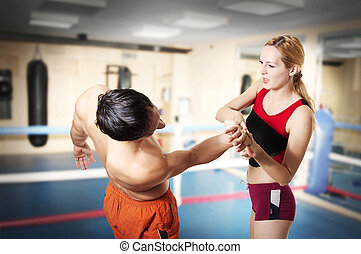 struggle. Young woman unscrews hand to guy - Couple workout...