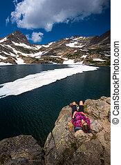 Tourist in Colorado Hiker Girl rests at Blue lake - Hiker...