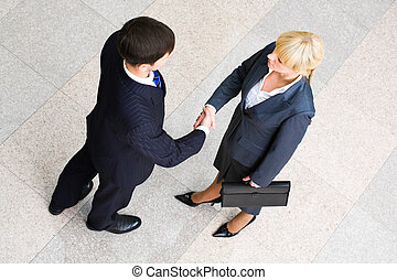 Business agreement - Image of business people standing and...