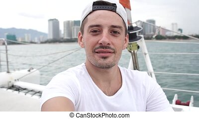 Man takes self portrait photo while enjoying vacation on a yacht