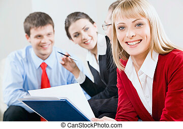 Business woman - Young beautiful woman is holding a document...