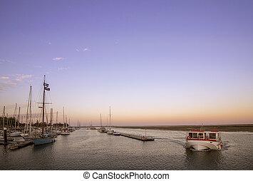 Olhao recreational boat Marina at dusk, the city is capital...