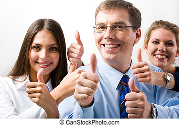 Success - Team of three office workers give the thumbs up...