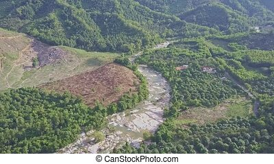 Drone Flies High above Pictorial Green Highland with River -...