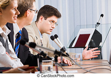 Man at a seminar - Photo of business man sitting at the...