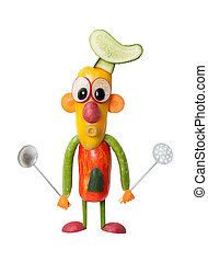 Funny cook made of vegetables with kitchen spoons