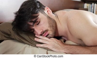 Young Sleepy Man, Lying in Bed Waking Up