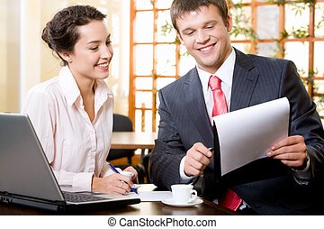 Meeting - Portrait of business man demonstrating a document...