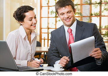 Demonstration - Business man is demonstrating a document to...