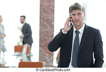 Serious businessman talking on the phone.