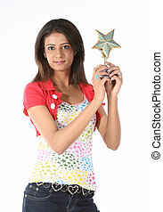 Teenage girl with star trophy