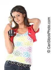 Teenage girl with gold trophy
