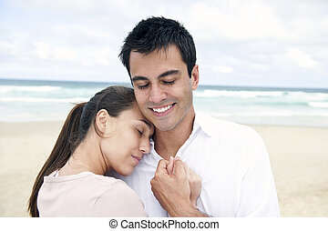 hispanic couple bonding on beach - serene hispanic couple...